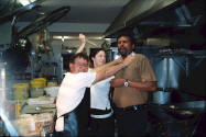 Photo of Huey Michelle and Raj in the kitchen at Gloucester Motel.